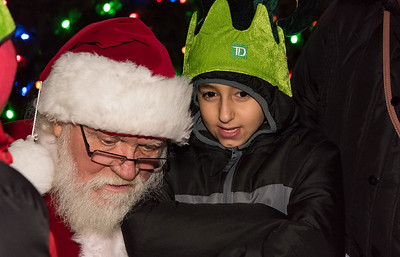 11/29/18  Wesley Bunnell | Staff   New Britain held their tree lighting ceremony with a visit from Santa on Thursday evening at Central Park. Joseph Filipkowski, age 11 tells Santa Claus his Christmas gift wishes.