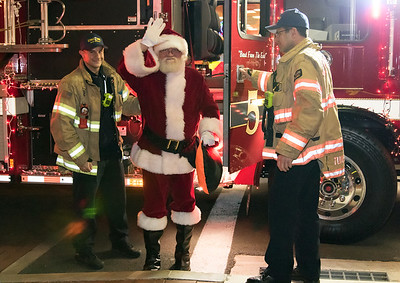 11/29/18  Wesley Bunnell | Staff   New Britain held their tree lighting ceremony with a visit from Santa on Thursday evening at Central Park.  Santa arrives at Central Park courtesy of the New Britain Fire Department's Engine 5 Beast from the East.
