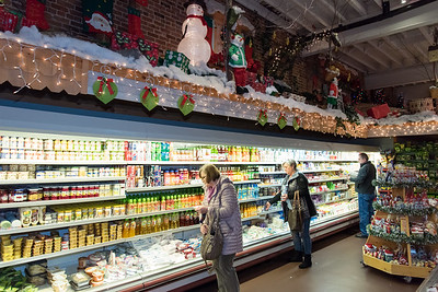 11/30/18  Wesley Bunnell | Staff  Shoppers at Roly Poly Bakery in New Britain are shown standing under a section of Christmas decorations on Friday afternoon.