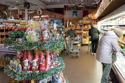 11/30/18  Wesley Bunnell | Staff  One of many stands featuring Christmas themed foods for sale as Nancy Campanario , middle, shops at Roly Poly Bakery in New Britain on Friday afternoon.