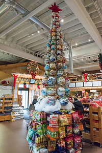 11/30/18  Wesley Bunnell | Staff  A Christmas tree made of decorations stands near the front entrance to Roly Poly Bakery on Friday afternoon.