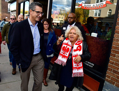 11/3/2018 Mike Orazzi | Staff Yvonne Krosky talks with Manny Santos, Sue Chapman and Tremell Collins with several other GOP hopefuls during a visit to New Britain's Little Poland Saturday.