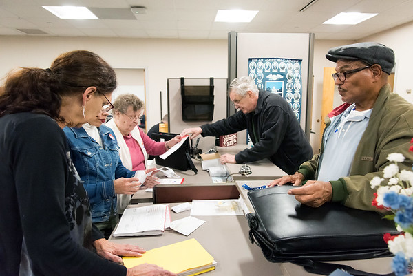 11/06/18 Wesley Bunnell | Staff Mario Santos, R, Moderator at the Chamberlian School voting location, hands in his locations ballots and paperwork at City Hall late on Tuesday night.