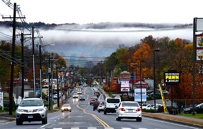 11/6/2018 Mike Orazzi | Staff Fog over downtown Bristol while looking West from the intersection of Route 6 and Oakland Street Tuesday afternoon.
