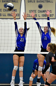 11/8/2018 Mike Orazzi | Staff Bristol Eastern High School's Aliana Rivoira (21) and Ryley Plourde (11) during the Class L Second Round State Girls Volleyball Tournament in Bristol Thursday night.
