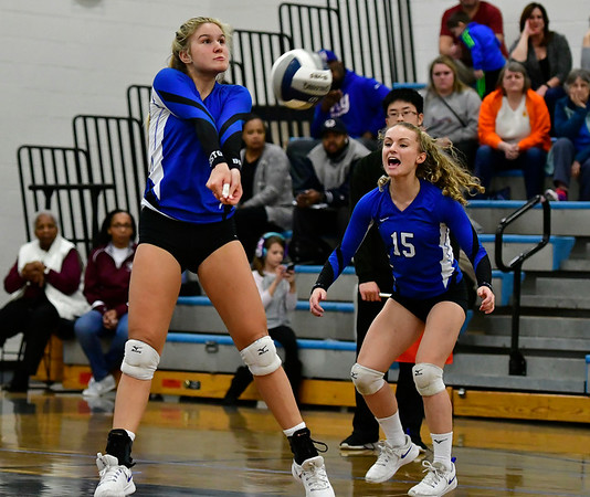 11/8/2018 Mike Orazzi | Staff Bristol Eastern High School's Zoe Lowe (7) and Rebecca Bender (15) during the Class L Second Round State Girls Volleyball Tournament in Bristol Thursday night.
