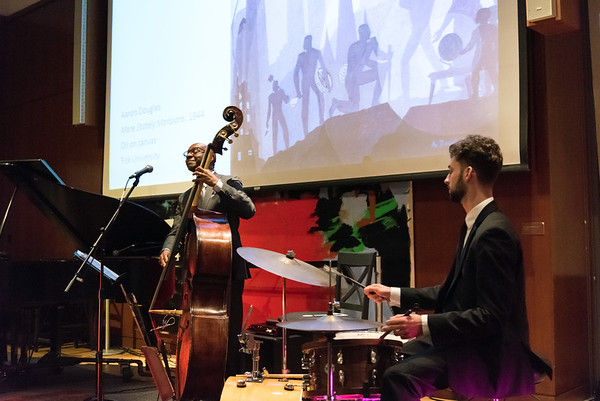 11/08/18 Wesley Bunnell | Staff The New Britain Museum of American Art held a special event Where Art Meets Music: Reconstructing the Rhythms of Black Histories through Contemporary Art on Thursday night. The presentation was narrated by Frank Mitchell and featured live music for the attendees. Shown are Nat Reeves on bass and Kirk Woodard on drums.