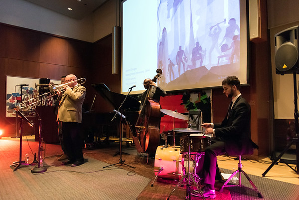 11/08/18 Wesley Bunnell | Staff The New Britain Museum of American Art held a special event Where Art Meets Music: Reconstructing the Rhythms of Black Histories through Contemporary Art on Thursday night. The presentation was narrated by Frank Mitchell and featured live music for the attendees. Shown are Steve Davis on trombone, Nat Reeves on bass and Kirk Woodard on drums.