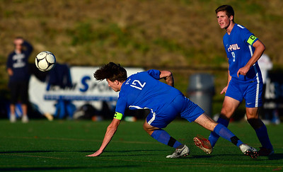11/8/2018 Mike Orazzi | Staff St. Paul Catholic High School's Adam Van Linter (12) and Stefan Zwolinski (9) during the Class S Second Round Boys Soccer Tournament held at the Farmington Sports Arena Thursday.