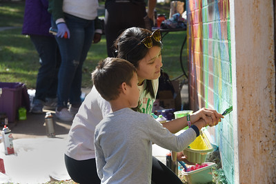 People of all ages spent a half-day last weekend painting a mural on an outside wall of the Ada Jenkins Center. (Photo by Bill Giduz)