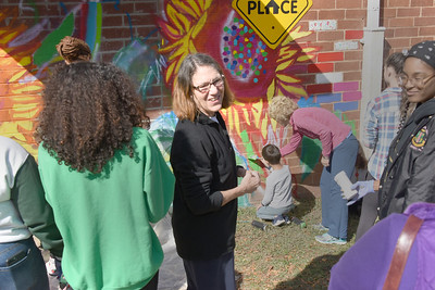 Ada Jenkins executive director Georgia Krueger dropped by to help paint the mural. (Bill Giduz photo)