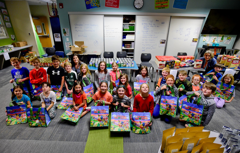 Kind Kid Club Packs Thanksgiving Meal Bags for Needy Families