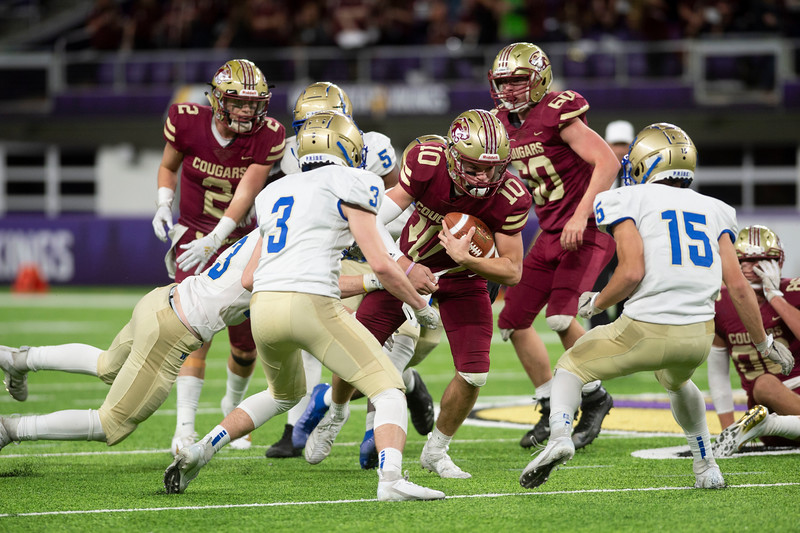 Freshman Blake Hanson, 10, looks to evade tackle at U.S. Bank Stadium on Friday, Nov. 15, 2019. Lakeville South was defeated 28-14 by Wayzata who advances to the finals of the AAAAAA prep bowl tournament.