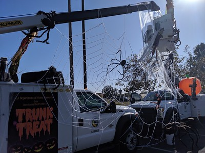 A large spider web hangs between cherry pickers Thursday at the Nelson Sports Complex in Oroville. (Jake Hutchison -- Enterprise-Record)