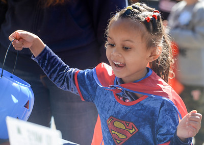 Amariah Exson,4, gets ready for some candy during the Treat Street event Thursday in downtown Chico. (Matt Bates -- Enterprise-Record)
