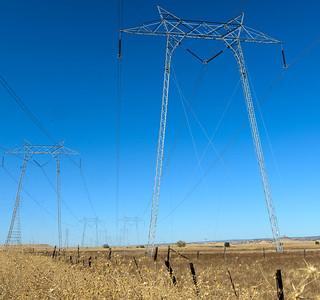 Power lines run through a dry grass field Tuesday in Oroville. (Matt Bates -- Enterprise-Record)