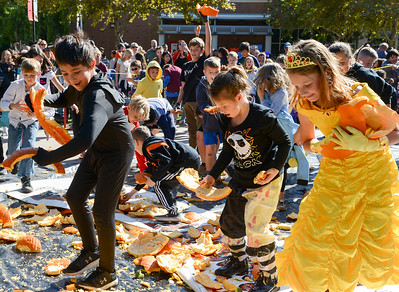 Kids swarm the drop zone to pick up pieces of pumpkins after the annual pumpkin drop at Chico State on Thursday in Chico. (Matt Bates -- Enterprise-Record)