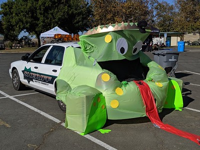 A patrol car is transformed into a giant green monster Thursday at the Nelson Sports Complex in Oroville. (Jake Hutchison -- Enterprise-Record)