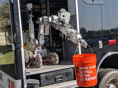A bomb squad robot holds a candy bucket Thursday at Trunk or Treat in Oroville. (Jake Hutchison -- Enterprise-Record)