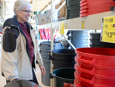Paradise resident Marilyn Keen shops for trash cans at Ace Hardware on Tuesday in Paradise. Keen's house survived the Camp Fire and she's now overwhelmed with loose debris and leaves. Ace Hardware, powered by generators, is one of a few businesses still open during the power outage. (Matt Bates -- Enterrpsie-Record)