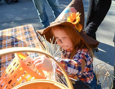 Harper Morgan, 2, scores a cool sticker during the Treat Street event Thursday in downtown Chico, California. (Matt Bates -- Enterprise-Record)