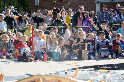 The crowd reacts to a pumpkin exploding during the annual pumpkin drop at Chico State on Thursday in Chico. (Matt Bates -- Enterprise-Record)