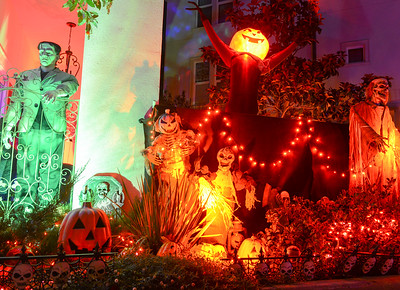 Condos are adorned with Halloween decorations on Hutchinson Street on Wednesday in Chico. The neighborhood residents welcome visitors and expect have over 1,000 people filter through the street on Halloween. (Matt Bates -- Enterprise-Record)