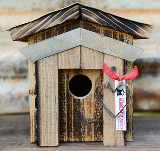 A birdhouse created entirely with salvaged remains of Honey Run Covered Bridge on Tuesday, October 29, 2019, in Chico, Califronia. (Matt Bates -- Enterprise-Record)