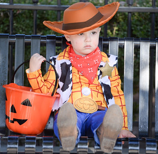 Dane Rosales, 2, takes a break from candy wrangling during the Treat Street event Thursday in downtown Chico. (Matt Bates -- Enterprise-Record)