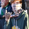 KEVIN HARVISON | Staff photo<br /> McAlester sophomore Jacob Plaxicio keeps warm as he works the OSSSA small school band contest at Hook Eales Stadium Wednesday morning.