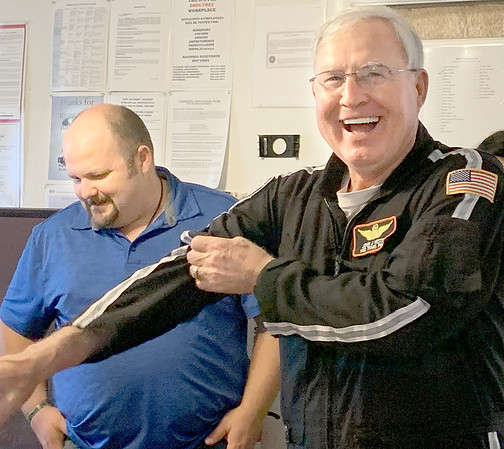 ADRIAN O'HANLON III | Staff photo<br /> John Hester laughs during a retirement party celebrating his 17-year career as a medical helicopter pilot.