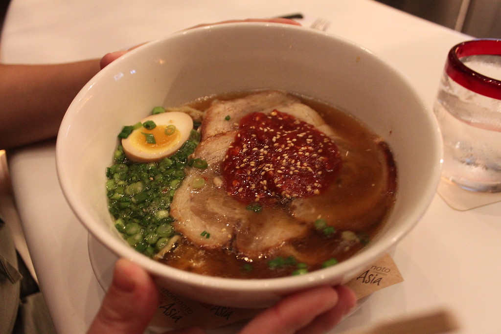 Heaping bowl of ramen with pork and a soft boiled egg