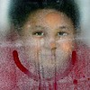 KEVIN HARVISON | Staff photo<br /> Kelan Duran looks ice-olated as he looks out the window frost-rated with the rest of the chill-dren as the cold weather keeps them inside for recess.