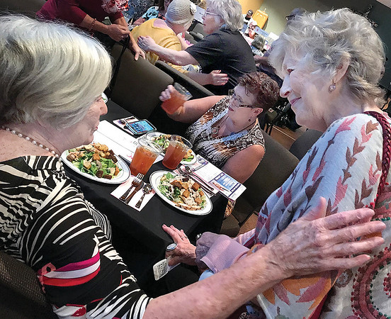 KEVIN HARVISON | Staff photo<br /> Hugs a plenty was on hand during the Annual Pink Ribbon Lunceon Event Thursday. Joe Ann Vermillion, left, visits before the start of the luncheon.