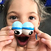 KEVIN HARVISON | Staff photo<br /> Naomi Gamino tries on a set of eyes from a Mr. Potato Head during some free time.