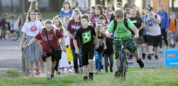 """KEVIN HARVISON   Staff photo<br /> Krebs teachers, parents and students participated in the """"walking school bus"""" Wednesday morning from Krebs City Hall to the Krebs School."""
