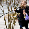 KEVIN HARVISON | Staff photo<br /> Pictured from left, Amanda Grantham and Anabel Grantham fight through the wind and rain after the wind destroyed the umbrella they was using Thursday morning.