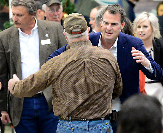 KEVIN HARVISON | Staff photo<br /> Oklahoma Governor Kevin Stitt makes his way to the podium before speaking at the McAlester Expo Center Thursday.