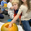 MINDI HARVISON | Submitted photo<br /> Emerson First Grade Student Naomi Gamino reacts to the inside of a pumpkin during a class project.