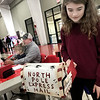 KEVIN HARVISON | Staff photo<br /> Emma Irwin, right, mails a letter to Santa while at the Santas Helper Fair Saturday.