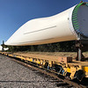 KEVIN HARVISON | Staff photo<br /> Blades for a wind turbin are pictured on a train going through McAlester Thursday.