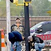 KEVIN HARVISON | Staff photo<br /> Built Right Construction workers prepare for the removal of the stop lights on Main Street and Choctaw Avenue Wednesday.