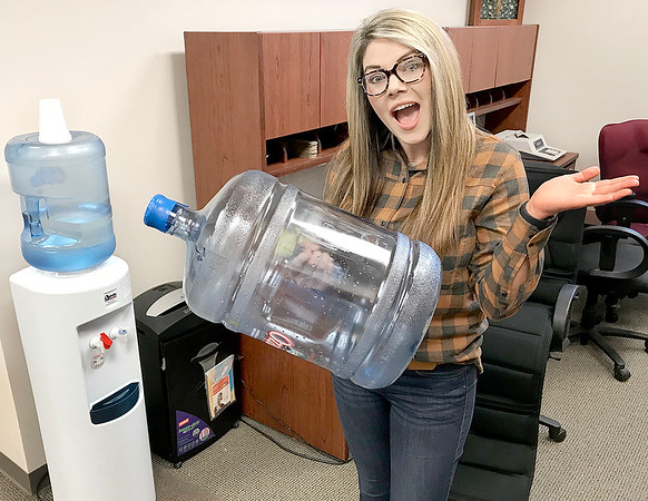 "KEVIN HARVISON | Staff photo<br /> Erica Wilson at the Pittsburg County Treasurers Office is pictured next to the ""haunted"" water cooler."