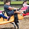 KEVIN HARVISON | Staff photo<br /> Pictured from left Ashley Faver, Dewayne Harrison and Persephanie Montgomery appear to be racing during on the playground equipment during a recent visit to Chadick Park.
