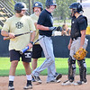 KEVIN HARVISON | Staff photo<br /> Former University of Oklahoma baseball star, Major League Baseball player and now McAlester High School Head Baseball Coach Brian Shackelford, third from left in black shirt, celebrates after hitting a homerun in his first at bat during the MHS Alumni Baseball game Saturday at Mike Deak Field.