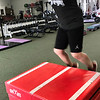 KEVIN HARVISON | Staff photo<br /> Cole Evans performs some box jumps during an after school program at Signature Fitness.