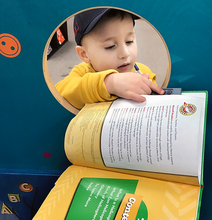 KEVIN HARVISON | Staff photo<br /> Two-year-old Dek McAfee enjoys spending time at the McAlester Public Library.