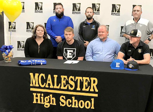 KEVIN HARVISON | Staff photo<br /> McAlester High School standout baseball player Cade Lott signed his National Letter of Intent Friday in the media room on the McAlester High School campus. Lott is a highly decorated player earning 2019 Baseball Factory Preseason All-American, 2019 Rawlings/Perfect Game Preseason Underclass All-American, 2019 Junior Sunbelt All-Tournament Team, 2019 Battle of the Borders All-Tournament Team and 2019 Perfect Game WWBA World Championship All-Tournament Team among other honors. Pictured from left seated, Darla Lott, Cade Lott, Brian Lott and McAlester Head Baseball Coach Brian Shackelford; and standing from left, Noe Ruiz, Eastern Oklahoma State Baseball Coach Noe Ruiz and Eastern Oklahoma State College Head Baseball Coach Matt Parker.