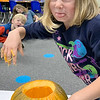 MINDI HARVISON | Submitted photo<br /> Emerson First Grade Student Brooklynn Frazier doesn't like the feel or smell the class pumpkin.