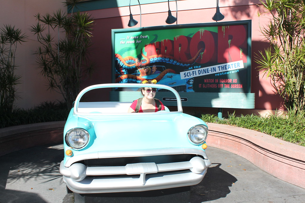 A girl sits inside a replica of a classic car at Disney's Hollywood Studios